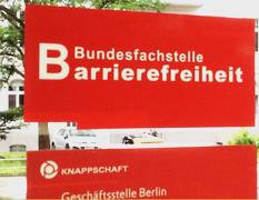 """Bild zeigt das Logo in weißem Schriftzug """"Bundesfachstelle Barrierefreiheit"""" auf rotem Hintergrund"""
